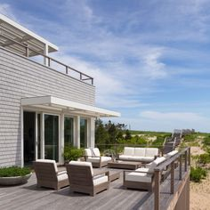 "Another design principle from Berke: ""Circulation does more than connect."" Functional elements on this outdoor terrace also encourage awareness of the beautiful surroundings. A wood pathway is a visual clue that the ocean can be found just over the dunes, while a railing above indicates that a guest can head to the upper deck for incredible views of the water."