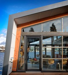 Mankoski, architect Ryan Mankoski of Ninebark Design Build and Dyna Contracting collaborated to create a cohesive design with an open layout. The result has two glass sides wide open to spectacular views of bay waters, the University of Washington and the mountains beyond.   Floating Houzz at a Glance Who lives here: A woman and her cats Location: Portage Bay (between Lake Washington and Lake Union), Seattle Size: 1,200 square feet, 1 bedroom, 1 bathroom
