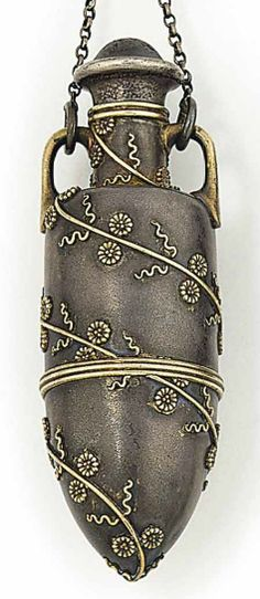A LATE 19TH CENTURY SILVER PENDANT, BY TIFFANY & CO, CIRCA 1890. Of ampoule design, the lower half opening to a vinaigrette, the top a perfume bottle, decorated with floral motifs, to a silver chain suspension. Signed Tiffany & Co., Union Square, numbered.