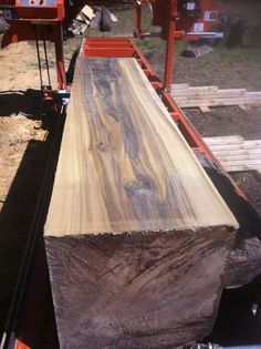 """Sawing a big poplar log, about 32"""" in diameter.   This log was my first attempt at quarter sawing lumber, and it turned out great.  Check out the olive and purple hues in the wood!  The top piece was re-sawed later.  WoodMizer LT15"""