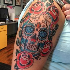 Dimonds Tattoo : Day of the dead tattoo on woman's shcoulder with diamonds cross and roses s