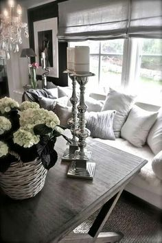Hydrengeas in basket and candles for a glamorous yet cozy living space.