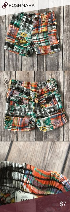 Old Navy Madras Shorts-Orange, Brown and Sea Green Old Navy Madras Shorts- Orange, Brown and Sea Green. Plaid with a tropical pattern. Two back pockets with flaps. Elastic waistband at back for comfortable fit. Very cute! Old Navy Bottoms Shorts