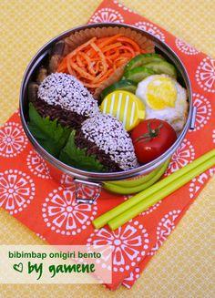 Angle sesame on onigiri! (also- carrot shred salad?)