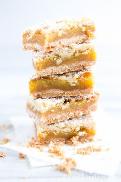 Orange Crumble Tart with Vanilla Bean | A buttery shortbread crust and crumble cradle creamy vanilla bean orange curd. An easy, flavorful dressed up dessert or casual bar. | VanillaAndBean.com