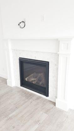 #whitelanedecor Whitelane Decor White wash wood floor, hexagon marble fireplace, craftsman fireplace mantel.