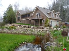 #3660 RODGERS Rd. Harrison. Beautiful large 3Bdrm. 3 Bath 1 ½ story home, cathedral knotty pine ceil., full finished walkout basement,  porches, deck, heated Att. garage, workshop & pole barn, 16x32 gable barn, on 30 secluded acres with creek. Must see all it has to offer! $399,900.  MLS 160652 Exclusive/Secluded