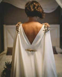 Ethereal goddess wedding dress with gold details and low back.