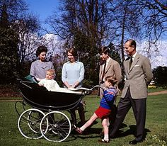 Queen Elizabeth II and The Duke of Edinburgh with Prince Charles and Princess Anne, Prince Edward in the pram and Prince Andrew in the red shorts, 1965.