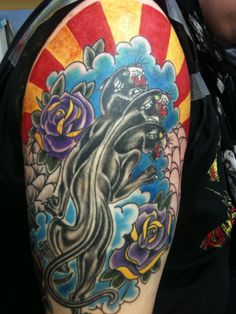 Beautifully coloured Tattoo on upper arm.