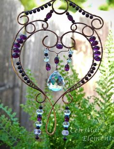 I love this beautiful beaded window sun catcher.