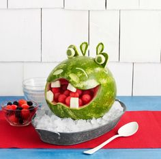 Cut a fun animal face out of your watermelon and fill their mouth with fruit, perfect for your child's summer birthday party.