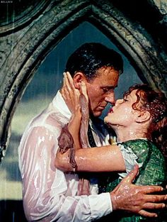 John Wayne and Maureen O'Hara - The Quiet Man (1952) What is it about these scenes of budding love in the rain amongst the ruins?  Sigh.....