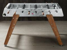 Every guy's place should have some sort of game table — pool, ping pong, foosball, or poker. We recommend this electropolished steel foosball table since it would look great in any loft space. Basement Games, Sectional Furniture, Rattan Furniture, Giant Inflatable, Table Games, Game Tables, Loft Spaces, Inspiration For Kids, Business For Kids