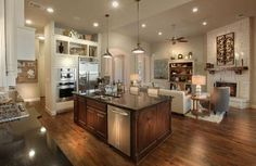 What if I stained our kitchen island a darker color like this and painted the cabinets on the walls? Kitchen by Drees Homes - Lauren II floor plan Painted Island, Work Triangle, Outdoor Living Areas, Walk In Pantry, Next At Home, My Dream Home, Custom Homes, Family Room, New Homes
