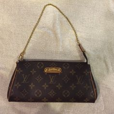 Louis Vuitton Eva clutch Louis Vuitton bag. Can be used as an evening clutch, or use gold chain as handle or can be used as a body cross over bag. Multi use Louis Vuitton Bags