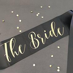The Bride Bachelorette Party Sash in Gold Glitter and Bla... https://www.amazon.com/dp/B01MRZS51E/ref=cm_sw_r_pi_dp_x_cRSwyb4P4SF7R