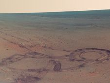 A 360-degree view combining 817 separate images displays features that surrounded NASA's Mars rover Opportunity during a four-month winter work campaign.