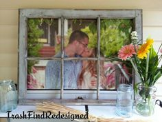 Adorable couple behind an old farmhouse repurposed window pane