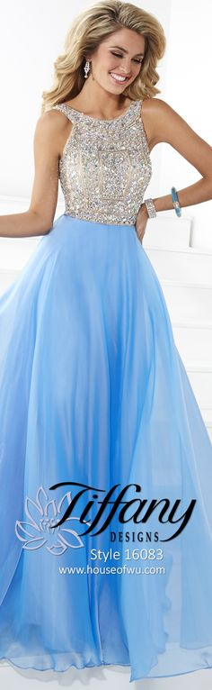 Make an unforgettable entrance in this sophisticated gown. The empire bodice has a high neckline and is adorned with hand-sewn beadwork. A circle skirt of iridescent chiffon has a sweep train, and the V-back closes with a center zipper. #prom