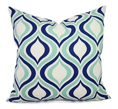 This listing is for two decorative throw pillow covers in a navy and mint trellis print. The background is a soft beige. These modern pillow