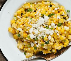 3-Ingredient Side Dishes for Summer #Entertaining: Liven up plain corn by grilling it until charred then adding feta and scallions #SelfMagazine