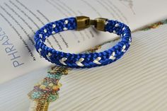 final look of the blue kumihimo braided friendship bracelet