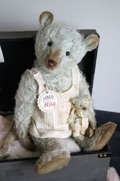 Hug Me Again Collectibles - Hug Me Again collectible teddy bear by V. Galli. Dressed and well aged.