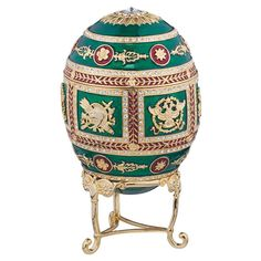 Over-the-top ornamentation characterizes this jeweler-style, museum-quality enameled egg first made famous by Carl Faberg in the 17th century. The Redonka lifts from its tripod base and opens to revea