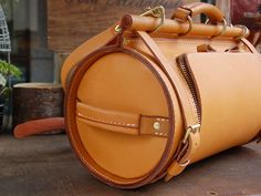 Designer Vegetable Tanned Leather Doctor Bag- Made of Italian top class vegetable tanned cow leather, this bag is uniquely designed with a cylinder shape, looking fashionable enough for an elegant lady to carry with.-SR
