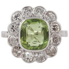 Edwardian Peridot Diamond Gold Platinum Ring | From a unique collection of vintage cluster rings at https://www.1stdibs.com/jewelry/rings/cluster-rings/