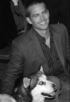"""Paul Walker and the Huskie animal actor he adopted after the filming for """"8 Below"""" wrapped. In addition to including his own dogs in his life, he fostered many dogs awaiting adoption"""
