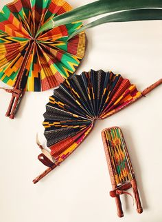 If these aren't fly I don't know what is. A Kente print accordion fan encased in leather, that easily pops out and folds on the go. Closed Length: Open Length: Print may vary slightly. Handmade in Ghana. African Fabric, African Art, Ghana Traditional Wedding, Traditional Dresses, How To Tie Shoes, African Accessories, Diy Fan, Tent Wedding, Wedding Decor