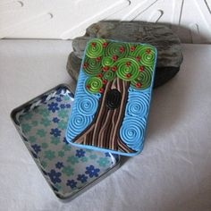 Apple Tree Cigarette Case Wallet from altered tin and polymer clay filligree. $60.00, via Etsy.