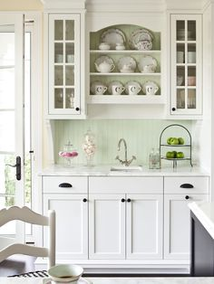 i was looking at this closely and this is exactly what we are doing but we are putting glass cabs all the way across the top and ours will not have a sink.  This just wouldn't look as 'cute & country' with black counters, IMHO. +country +oil Rubbed Bronze +white Cabinets Design, Pictures, Remodel, Decor and Ideas