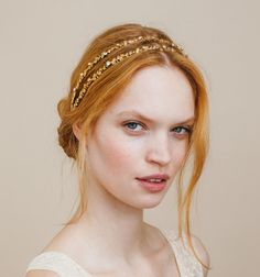 Two rows of golden stampings studed with petite Swarovski crystals make up this subtle and super wearable headwrap. A sweet and feminine headband perfect for pairing with a vintage lace dress. You can wear this piece with hair up or down, hiding the elastic at back under strands of hair or within an updo. Handmade in New York City. $452.00