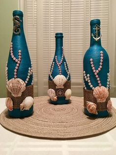 This bottle is hand wrapped in teal thread and then decorated with real sea shells, faux pearls, mesh and metal emblem. It is perfect for any beach fanatic and sea lover, bringing the feel of the ocean into your home. **MADE IN AMERICA** Every bottle or glass is wrapped carefully by #decoratedwinebottles