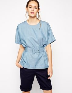 Top by Antipodium Crisp woven fabric Round neckline Turn-up cuffs Belted, high waist Buttoned, keyhole fastening to the reverse Regular fit - true to size Hand wash 100% Cotton Our model wears a UK S/EU S/US XS