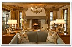 warm living room with fireplace   design by collins-interiors.com