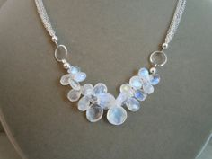moonstone. Reminder for half n half designs, similar to the amethyst and turquoise shell necklaces.