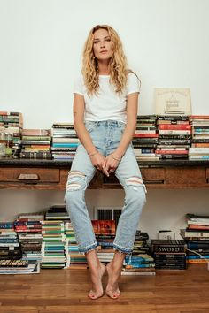 Erin Wasson wears a loose white t-shirt paired with baggy white-wash denim boyfriend jeans