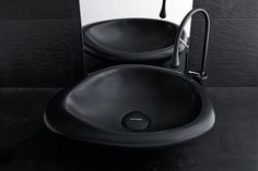 The particular shape of #Sasso creates a unique and fascinating atmosphere. #MastellaDesign #basin #washbasin #blackandwhite #bathdesign #bathroom #design