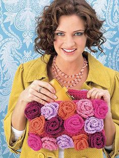 This tutorial is for a pretty flower bloom purse. On a larger scale, it could be a really unique afghan.
