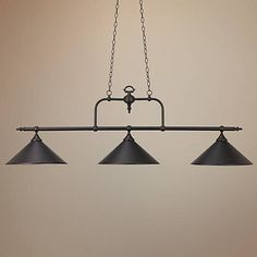 Illuminate your billiard table with this three light tiffany bronze chandelier.