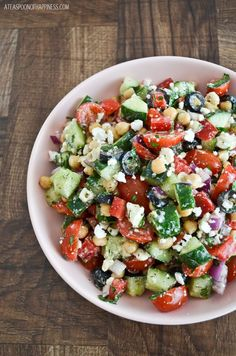MEDITERRANEAN CHICKPEA SALAD: chickpeas, cherry tomatoes, cucumber, red bell pepper, red onion, black olives, feta cheese