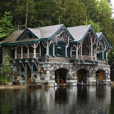 Camp Topridge in the Adirondacks, New York - This Adirondack Great Camp was bought in 1920 and substantially expanded and renovated in 1923 by Marjorie Merriweather Post. The beautiful retreat was once accessible only by boat or floatplane and features lovely boathouses with tree-like support columns. Camp Topridge consists of 68 buildings, including private guest cabins and a main lodge with a movie theater.