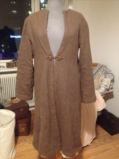 Jacket. Brown, thick wool lined with white, raw silk.
