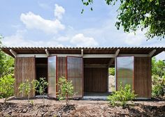 These sustainable huts could help solve Vietnam's housing crisis with the woven walls, translucent plastic doors and slanted corrugated metal roofing.