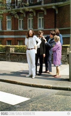The Beatles preparing for the Abbey Road photo.