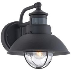 "Fallbrook Black 9"" High Motion Sensor Outdoor Wall Light - $79.99. Has a dusk-to-dawn feature so you can have it on but it will brighten when it detects motion."